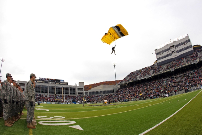 Nov 9, 2013; West Point, NY, USA; A member of the West Point parachute team jumps on to the field before the first half at Michie Stadium. Mandatory Credit: Danny Wild-USA TODAY Sports