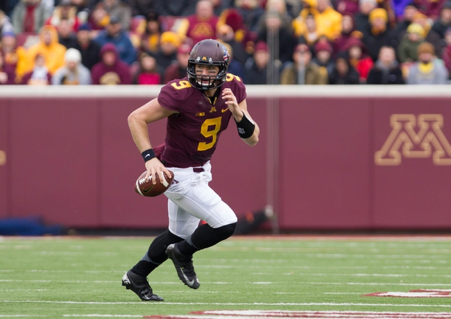 Nov 9, 2013; Minneapolis, MN, USA; Minnesota Gophers quarterback Philip Nelson (9) runs out of the pocket in the first quarter against the Penn State Nittany Lions at TCF Bank Stadium. Mandatory Credit: Brad Rempel-USA TODAY Sports