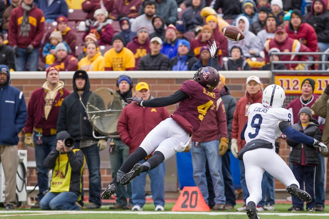 Nov 9, 2013; Minneapolis, MN, USA; Minnesota Gophers quarterback Donovahn Jones (4) dives for a pass in the fourth quarter against the Penn State Nittany Lions at TCF Bank Stadium. Minnesota wins 24-10. Mandatory Credit: Brad Rempel-USA TODAY Sports