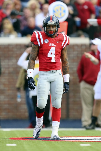 Nov 9, 2013; Oxford, MS, USA; Mississippi Rebels linebacker Denzel Nkemdiche (4) during the game against the Arkansas Razorbacks at Vaught-Hemingway Stadium. Mississippi Rebels defeat the Arkansas Razorbacks with a score of 34-24.  Mandatory Credit: Spruce Derden-USA TODAY Sports