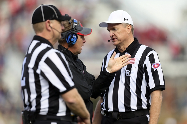 Nov 9, 2013; Oxford, MS, USA; Mississippi Rebels head coach Hugh Freeze discusses a call with the officials during the game against the Arkansas Razorbacks at Vaught-Hemingway Stadium. Mississippi Rebels defeat the Arkansas Razorbacks with a score of 34-24.  Mandatory Credit: Spruce Derden-USA TODAY Sports