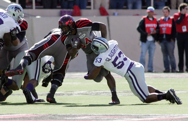 Nov 9, 2013; Lubbock, TX, USA; Texas Tech Red Raiders running back Kenny Williams (34) is tackled by Kansas State Wildcats middle line backer Blake Slaughter (54) in the first half at Jones AT&T Stadium. Mandatory Credit: Michael C. Johnson-USA TODAY Sports
