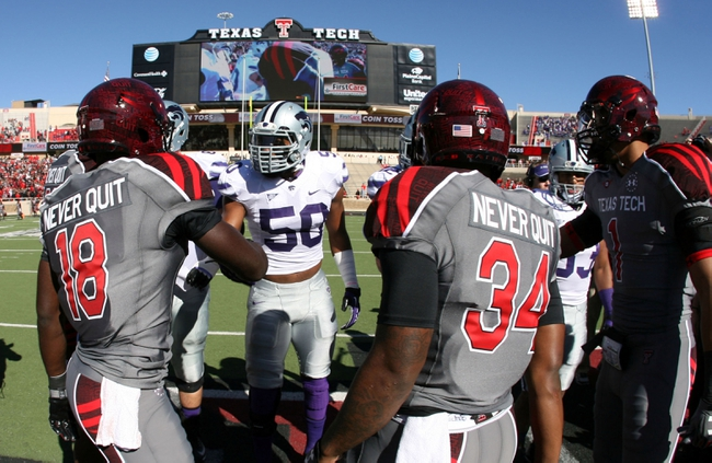 Nov 9, 2013; Lubbock, TX, USA; Texas Tech Red Raiders wide receiver Eric Ward (18) and running back Kenny Williams (34) greet Kansas State Wildcats defensive line backer Tre Walker (50) during the coin toss before the game at Jones AT&T Stadium. Mandatory Credit: Michael C. Johnson-USA TODAY Sports