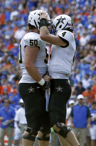 Nov 9, 2013; Gainesville, FL, USA; Vanderbilt Commodores quarterback Patton Robinette (4) and Vanderbilt Commodores offensive linesman Andrew Jelks (50) congratulate each other after they scored a touchdown against the Florida Gators during the second half at Ben Hill Griffin Stadium. Vanderbilt Commodores defeated the Florida Gators 34-17. Mandatory Credit: Kim Klement-USA TODAY Sports