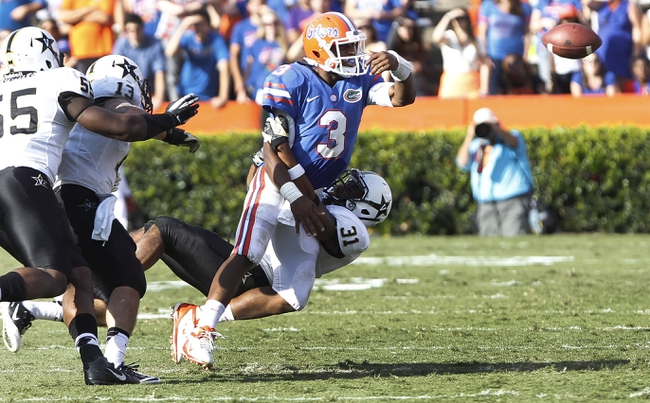 Nov 9, 2013; Gainesville, FL, USA; Florida Gators quarterback Tyler Murphy (3) is called for intentional grounding as Vanderbilt Commodores safety Javon Marshall (31) tackles him during the second half at Ben Hill Griffin Stadium. Vanderbilt Commodores defeated the Florida Gators 34-17. Mandatory Credit: Kim Klement-USA TODAY Sports