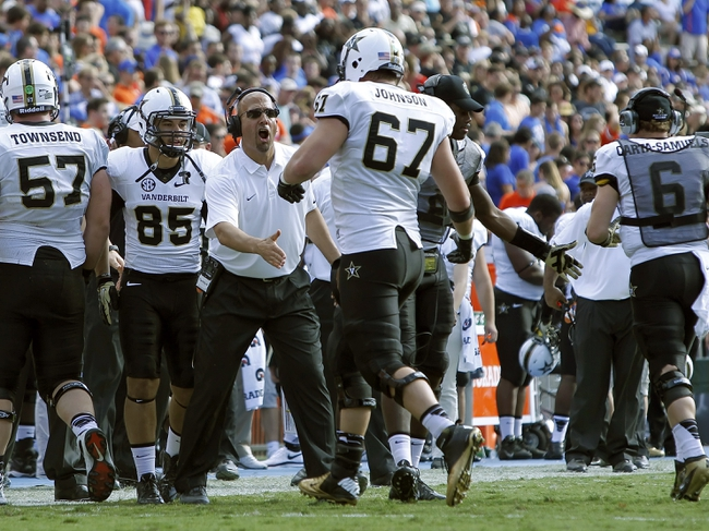 Nov 9, 2013; Gainesville, FL, USA; Vanderbilt Commodores head coach James Franklin celebrates with offensive linesman Wesley Johnson (67) after they scored a touchdown against the Florida Gators during the second half at Ben Hill Griffin Stadium. Vanderbilt Commodores defeated the Florida Gators 34-17. Mandatory Credit: Kim Klement-USA TODAY Sports