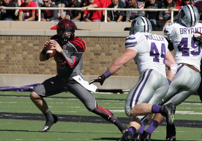Nov 9, 2013; Lubbock, TX, USA; Texas Tech Red Raiders quarterback Baker Mayfield (6) looks for an open receiver against the Kansas State Wildcats in the second half at Jones AT&T Stadium. Mandatory Credit: Michael C. Johnson-USA TODAY Sports