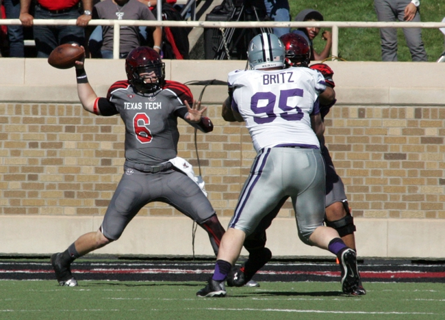 Nov 9, 2013; Lubbock, TX, USA; Texas Tech Red Raiders quarterback Baker Mayfield (6) passes against the Kansas State Wildcats in the second half at Jones AT&T Stadium. Mandatory Credit: Michael C. Johnson-USA TODAY Sports