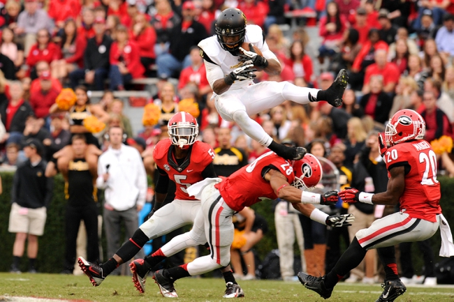 Nov 9, 2013; Athens, GA, USA; Appalachian State Mountaineers wide receiver Tony Washington (15) makes a catch and is tackled by Georgia Bulldogs safety Tray Matthews (28)  during the second half at Sanford Stadium. Georgia defeated Appalachian State 45-6. Mandatory Credit: Dale Zanine-USA TODAY Sports