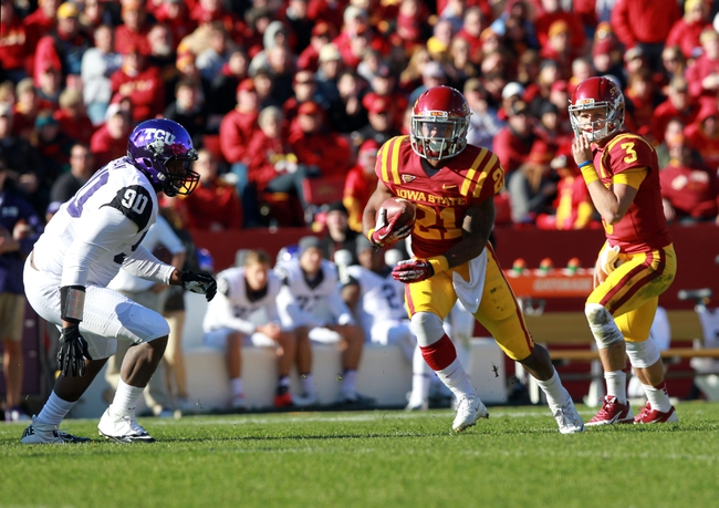 Nov 9, 2013; Ames, IA, USA;  Iowa State Cyclones quarterback Grant Rohach (3) hands of to running back  Shontrelle Johnson (21) against the Texas Christian Horned Frogs at Jack Trice Stadium.  Texas Christian beat Iowa State 21-17.  Mandatory Credit: Reese Strickland-USA TODAY Sports
