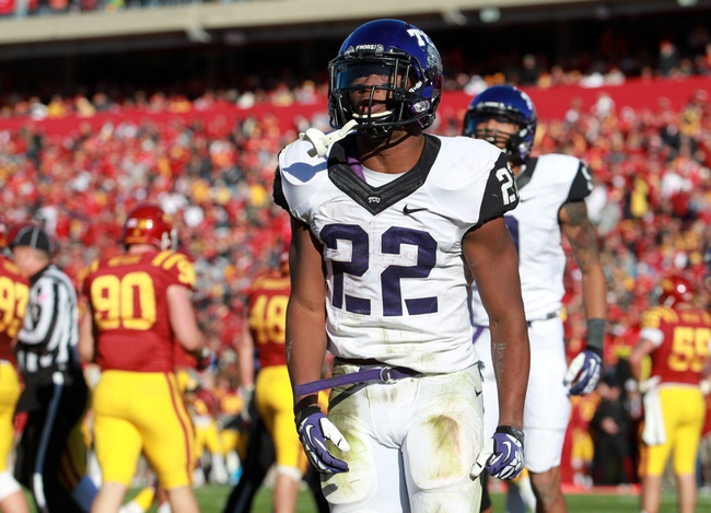 Nov 9, 2013; Ames, IA, USA; Texas Christian Horned Frogs running back Aaron Green (22) celebrates after the game winning touchdown against the Iowa State Cyclones at Jack Trice Stadium.  Texas Christian beat Iowa State 21-17.  Mandatory Credit: Reese Strickland-USA TODAY Sports