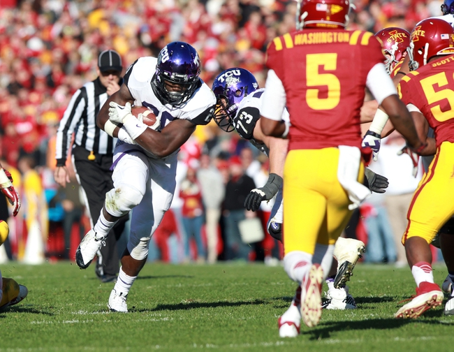Nov 9, 2013; Ames, IA, USA; Texas Christian Horned Frogs running back Jordan Moore (29) runs the football against the Iowa State Cyclones defensive at Jack Trice Stadium.  Texas Christian beat Iowa State 21-17.  Mandatory Credit: Reese Strickland-USA TODAY Sports