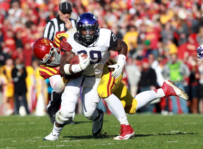 Nov 9, 2013; Ames, IA, USA; Texas Christian Horned Frogs running back Jordan Moore (29) is tackled by Iowa State Cyclones defensive tackle Rodney Coe (9) at Jack Trice Stadium.  Texas Christian beat Iowa State 21-17.  Mandatory Credit: Reese Strickland-USA TODAY Sports