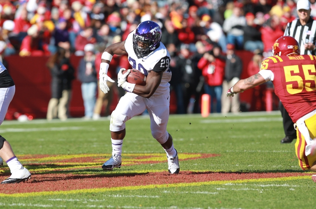 Nov 9, 2013; Ames, IA, USA; Texas Christian Horned Frogs running back Jordan Moore (29) runs the football against the Iowa State Cyclones at Jack Trice Stadium. Mandatory Credit: Reese Strickland-USA TODAY Sports