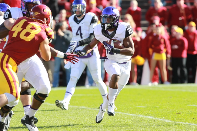 Nov 9, 2013; Ames, IA, USA; Texas Christian Horned Frogs running back Aaron Green (22) runs the football  against the Iowa State Cyclones at Jack Trice Stadium. Mandatory Credit: Reese Strickland-USA TODAY Sports
