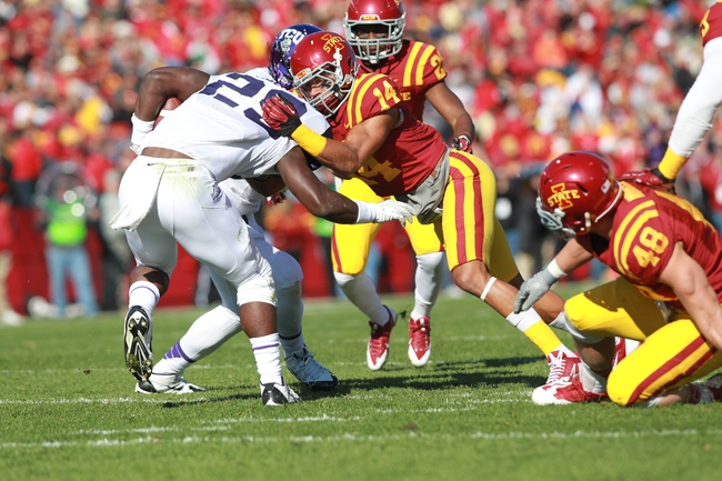 Nov 9, 2013; Ames, IA, USA; Texas Christian Horned Frogs running back B.J. Catalon (23) is tackled by Iowa State Cyclones linebacker Jared Brackens (14) at Jack Trice Stadium. Mandatory Credit: Reese Strickland-USA TODAY Sports