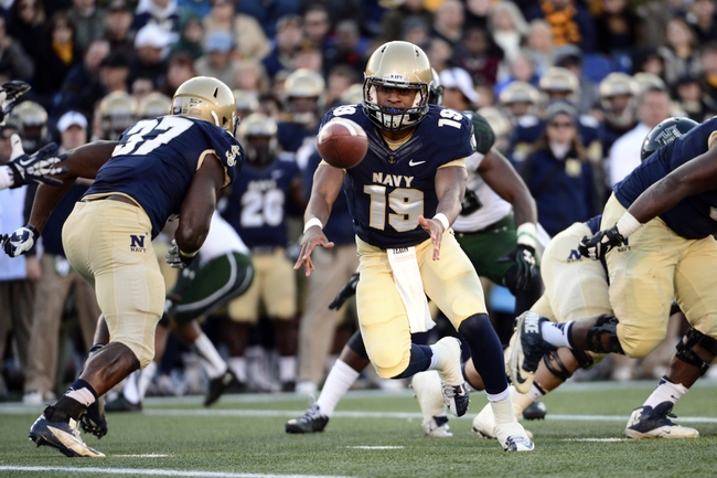 Nov 9, 2013; Annapolis, MD, USA; Navy Midshipmen quarterback Keenan Reynolds (19) tosses the ball during the first quarter of the Hawaii Warriors vs Navy Midshipmen game at Navy Marine Corps Memorial Stadium. Mandatory Credit: Tommy Gilligan-USA TODAY Sports