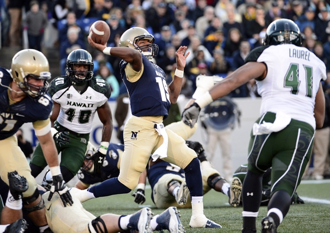 Nov 9, 2013; Annapolis, MD, USA; Navy Midshipmen quarterback Keenan Reynolds (19) throws the ball during the first quarter of the Hawaii Warriors vs Navy Midshipmen game at Navy Marine Corps Memorial Stadium. Mandatory Credit: Tommy Gilligan-USA TODAY Sports