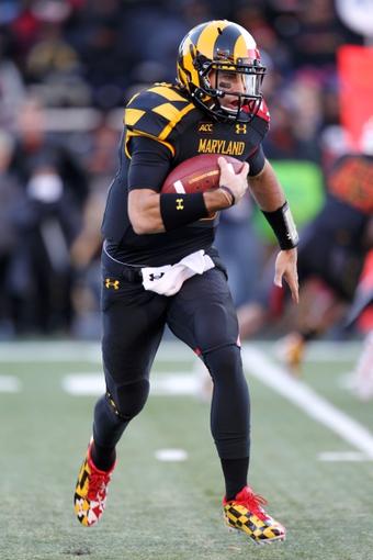 Nov 9, 2013; College Park, MD, USA; Maryland Terrapins quarterback C.J. Brown (16) runs for a gain against the Syracuse Orange at Byrd Stadium. Mandatory Credit: Mitch Stringer-USA TODAY Sports