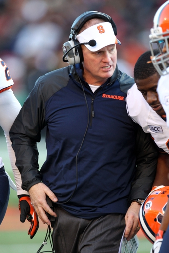 Nov 9, 2013; College Park, MD, USA; Syracuse Orange head coach Scott Shafer talks with players during the game against the Maryland Terrapins at Byrd Stadium. Mandatory Credit: Mitch Stringer-USA TODAY Sports