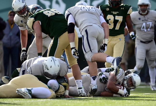 Nov 9, 2013; Fort Collins, CO, USA; Nevada Wolf running back Chris Solomon (20) scores on a one yard rushing touchdown in the second quarter against the Colorado State Rams at Hughes Stadium. Mandatory Credit: Ron Chenoy-USA TODAY Sports