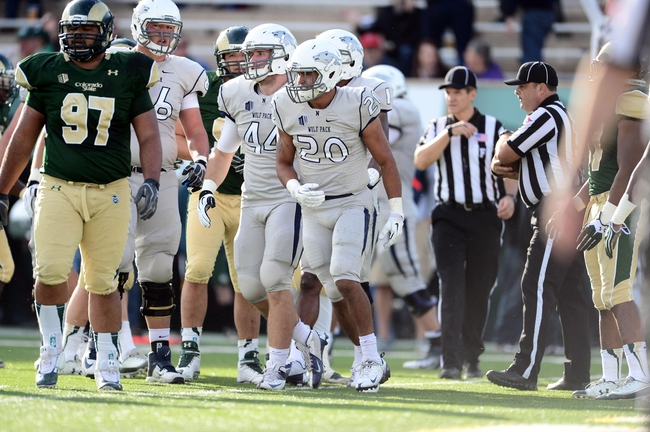 Nov 9, 2013; Fort Collins, CO, USA; Nevada Wolf running back Chris Solomon (20) reacts to his one yard using touchdown in the second quarter against the Colorado State Rams at Hughes Stadium. Mandatory Credit: Ron Chenoy-USA TODAY Sports