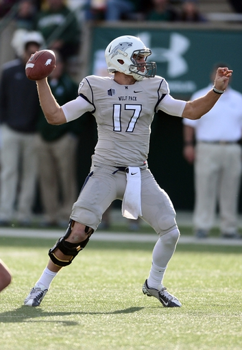 Nov 9, 2013; Fort Collins, CO, USA; Nevada Wolf Pack quarterback Cody Fajardo (17) prepares to pass in the second quarter against the Colorado State Rams at Hughes Stadium. Mandatory Credit: Ron Chenoy-USA TODAY Sports