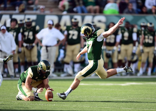 Nov 9, 2013; Fort Collins, CO, USA; Colorado State Rams kicker Jared Roberts (47) attempts and makes a forty five yard field goal as wide receiver Joe Hansley (25) holds in the second quarter against the Nevada Wolf Pack at Hughes Stadium. Mandatory Credit: Ron Chenoy-USA TODAY Sports