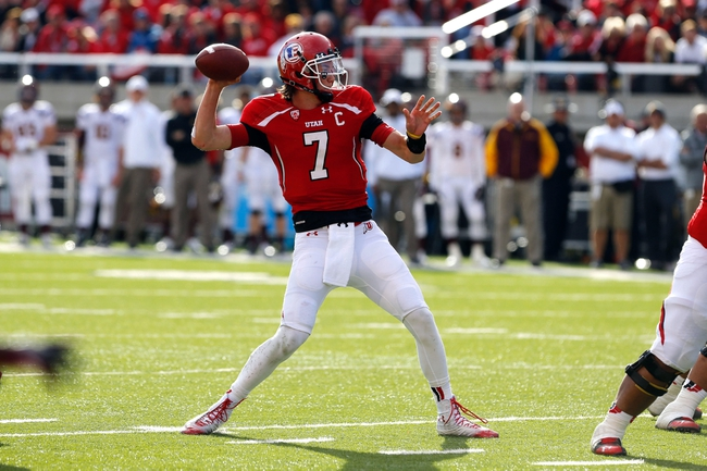 Nov 9, 2013; Salt Lake City, UT, USA; Utah Utes quarterback Travis Wilson (7) throws the ball down the field in the game against the Arizona State Sun Devils during the first quarter at Rice-Eccles Stadium. Mandatory Credit: Chris Nicoll-USA TODAY Sports