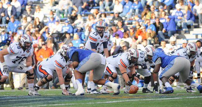Nov 9, 2013; Memphis, TN, USA; Tennessee Martin Skyhawks quarterback Jarod Neal (13) calls a play against Memphis Tigers during the first quarter at Liberty Bowl Memorial. Mandatory Credit: Justin Ford-USA TODAY Sports