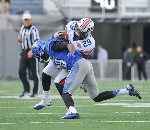 Nov 9, 2013; Memphis, TN, USA; Memphis Tigers defensive lineman Ricky Hunter (91) tackles Tennessee Martin Skyhawks running back Abou Toure (29) during the first quarter at Liberty Bowl Memorial. Mandatory Credit: Justin Ford-USA TODAY Sports