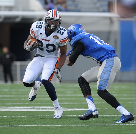 Nov 9, 2013; Memphis, TN, USA; Tennessee Martin Skyhawks running back Abou Toure (29) carries the ball against Memphis Tigers defensive back Anthony Watson (19) during the first quarter at Liberty Bowl Memorial. Mandatory Credit: Justin Ford-USA TODAY Sports