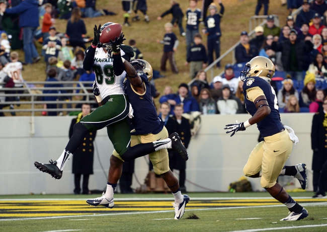 Nov 9, 2013; Annapolis, MD, USA; Hawaii Warriors wide receiver Keith Kirkwood (89) catches a pass for a touchdown during the second quarter of the Hawaii Warriors vs Navy Midshipmen game at Navy Marine Corps Memorial Stadium. Mandatory Credit: Tommy Gilligan-USA TODAY Sports