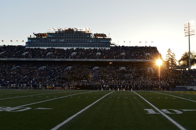 Nov 9, 2013; Annapolis, MD, USA; The sunsets behind the Brigade of Midshipman during the second quarter of the Hawaii Warriors vs Navy Midshipmen game at Navy Marine Corps Memorial Stadium. Mandatory Credit: Tommy Gilligan-USA TODAY Sports