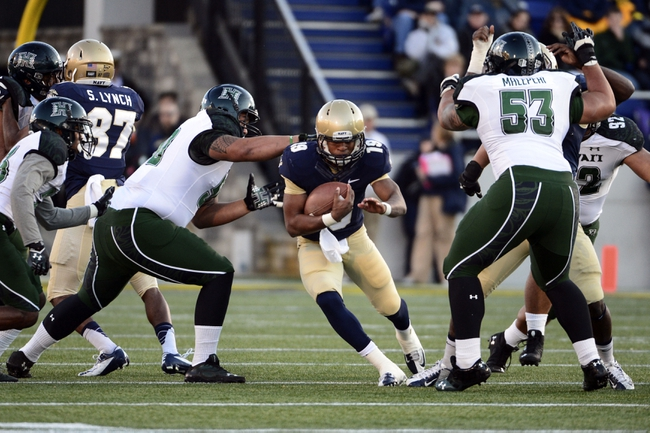 Nov 9, 2013; Annapolis, MD, USA; Navy Midshipmen quarterback Keenan Reynolds (19) runs with the ball through the line during the first quarter of the Hawaii Warriors vs Navy Midshipmen game at Navy Marine Corps Memorial Stadium. Mandatory Credit: Tommy Gilligan-USA TODAY Sports
