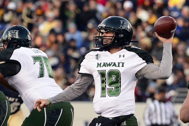 Nov 9, 2013; Annapolis, MD, USA; Hawaii Warriors quarterback Sean Schroeder (19) thaws a pass during the quarter of the Hawaii Warriors vs Navy Midshipmen game at Navy Marine Corps Memorial Stadium. Mandatory Credit: Tommy Gilligan-USA TODAY Sports