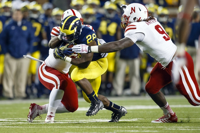 Nov 9, 2013; Ann Arbor, MI, USA; Nebraska Cornhuskers defensive end Jason Ankrah (9) and linebacker Michael Rose (15) tackle Michigan Wolverines running back Fitzgerald Toussaint (28) in the third quarter at Michigan Stadium. Mandatory Credit: Rick Osentoski-USA TODAY Sports