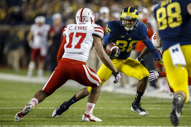 Nov 9, 2013; Ann Arbor, MI, USA; Nebraska Cornhuskers cornerback Ciante Evans (17) moves to tackle Michigan Wolverines tight end Jake Butt (88) in the third quarter at Michigan Stadium. Mandatory Credit: Rick Osentoski-USA TODAY Sports