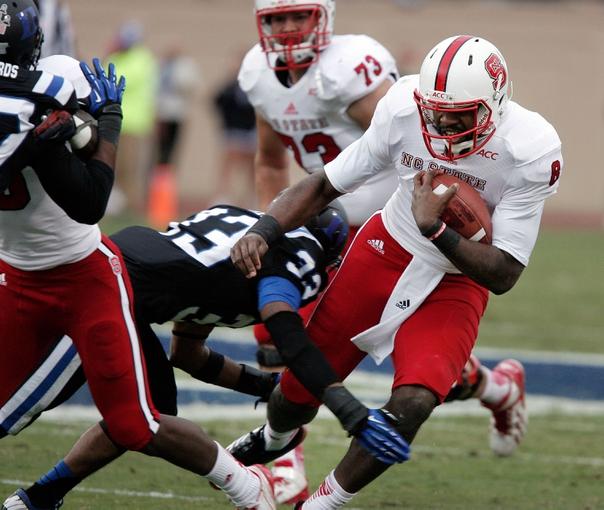 Nov 9, 2013; Durham, NC, USA; North Carolina State Wolfpack quarterback Brandon Mitchell (8) keeps the ball for a run against the North Carolina State Wolfpack at Wallace Wade Stadium. Mandatory Credit: Mark Dolejs-USA TODAY Sports