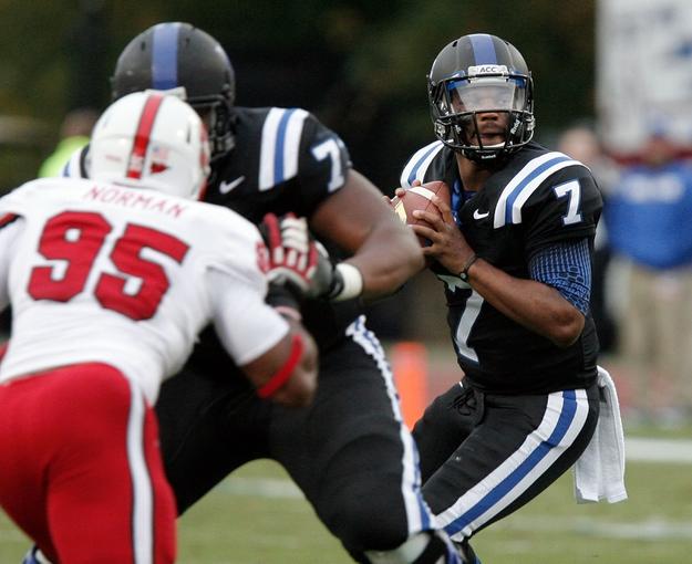 Nov 9, 2013; Durham, NC, USA; Duke Blue Devils quarterback Anthony Boone (7) looks to pass against the North Carolina State Wolfpack at Wallace Wade Stadium. Mandatory Credit: Mark Dolejs-USA TODAY Sports