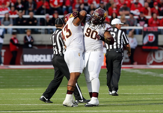Nov 9, 2013; Salt Lake City, UT, USA; Arizona State Sun Devils defensive tackle Will Sutton (90) and defensive end Davon Coleman (43) celebrate during the second quarter against the Utah Utes at Rice-Eccles Stadium. Mandatory Credit: Chris Nicoll-USA TODAY Sports