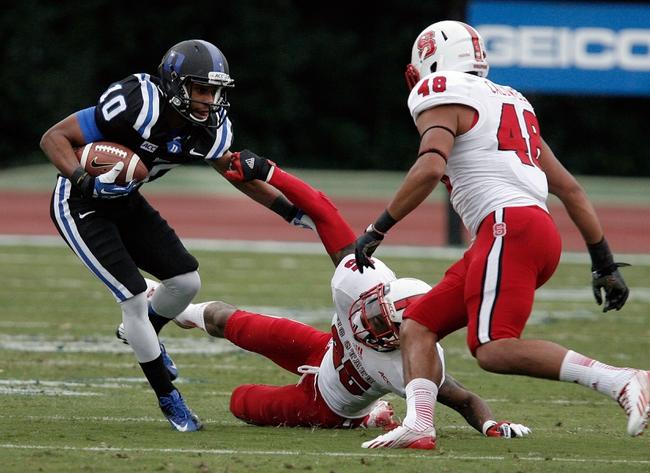 Nov 9, 2013; Durham, NC, USA; Duke Blue Devils wide receiver Ryan Smith (10) pulls away from North Carolina State Wolfpack cornerback Dontae Johnson (25) at Wallace Wade Stadium. Mandatory Credit: Mark Dolejs-USA TODAY Sports
