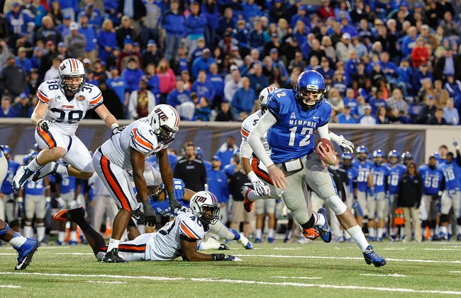 Nov 9, 2013; Memphis, TN, USA; Memphis Tigers quarterback Paxton Lynch (12) rushes for a touchdown against Tennessee Martin Skyhawks during the second quarter at Liberty Bowl Memorial. Mandatory Credit: Justin Ford-USA TODAY Sports