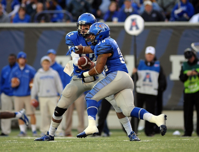Nov 9, 2013; Memphis, TN, USA; Memphis Tigers quarterback Paxton Lynch (12) hands the ball to running back Brandon Hayes (38) against Tennessee Martin Skyhawks during the second quarter at Liberty Bowl Memorial. Mandatory Credit: Justin Ford-USA TODAY Sports