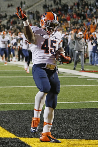 Nov 9, 2013; College Park, MD, USA; Syracuse Orange running back Jerome Smith (45) celebrates his rushing touchdown against the Maryland Terrapins at Byrd Stadium. Mandatory Credit: Mitch Stringer-USA TODAY Sports