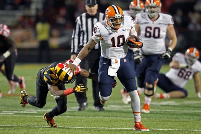 Nov 9, 2013; College Park, MD, USA; Syracuse Orange quarterback Terrel Hunt (10) gains yardage against the Maryland Terrapins at Byrd Stadium. Mandatory Credit: Mitch Stringer-USA TODAY Sports