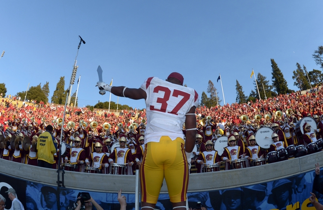 Nov 9, 2013; Berkeley, CA, USA; Southern California Trojans tailback Javorius Allen (37) conducts the Spirit of Troy marching band after the game against the California Golden Bears at Memorial Stadium. USC defeated California 62-28. Mandatory Credit: Kirby Lee-USA TODAY Sports
