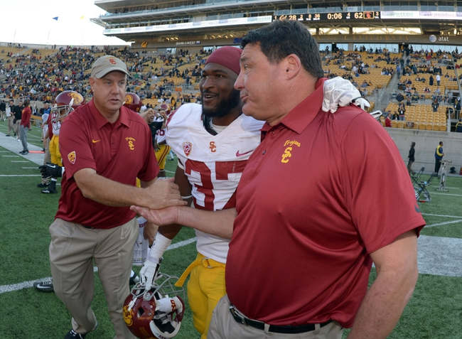 Nov 9, 2013; Berkeley, CA, USA; Southern California Trojans coach Ed Orgeron (right), tailback Javorius Allen (37) and special teams coach John Baxter celebrate at the end of the game against the California Golden Bears at Memorial Stadium. USC defeated California 62-28. Mandatory Credit: Kirby Lee-USA TODAY Sports