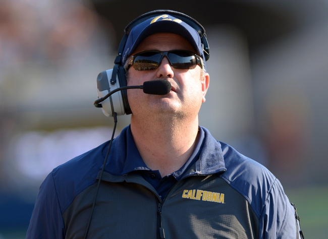Nov 9, 2013; Berkeley, CA, USA; California Golden Bears coach Sonny Dykes react during the game against the Southern California Trojans at Memorial Stadium. USC defeated California 62-28. Mandatory Credit: Kirby Lee-USA TODAY Sports