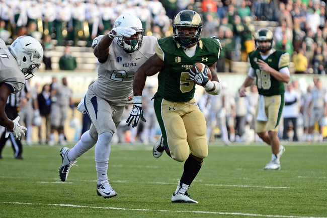 Nov 9, 2013; Fort Collins, CO, USA; Nevada Wolf Pack defensive back Charles Garrett (24) attempts to tackle Colorado State Rams running back Kapri Bibbs (5) in the third quarter at Hughes Stadium. The Rams defeated the Wolf Pack 38-17.Mandatory Credit: Ron Chenoy-USA TODAY Sports